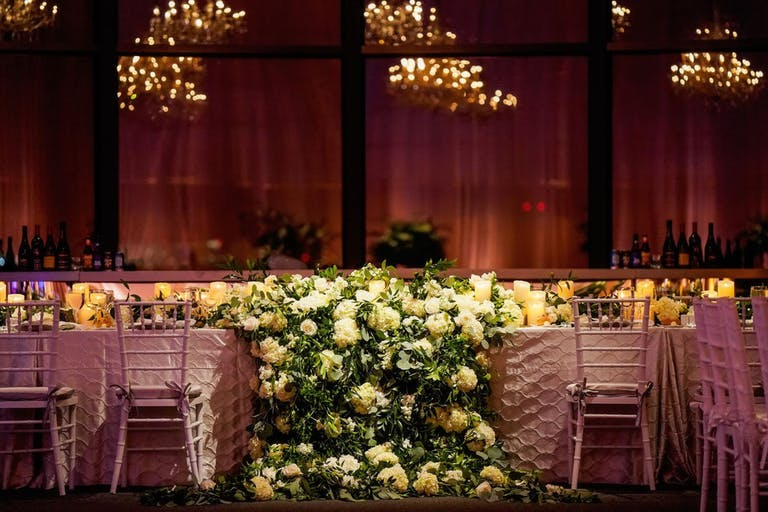 Reception Table With Lavish Greenery Wedding Centerpieces Cascading Off Table   PartySlate