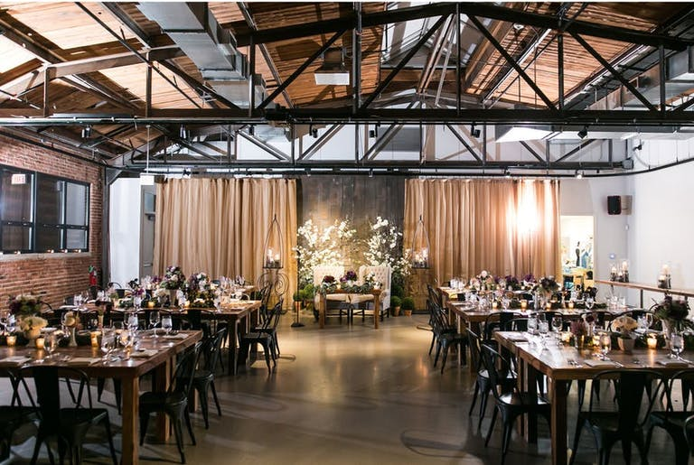 Rustic Chic Wedding Reception at Ovation in West Loop With Dark Wooden Beams | PartySlate