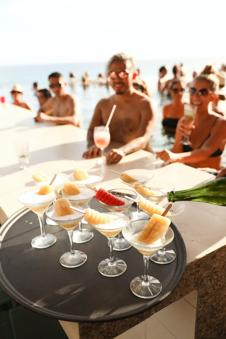 Friends Enjoy Poolside Popsicles in Martini Glasses | PartySlate