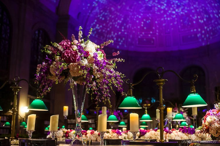 Boston Public Library Wedding With Purple Ceiling Lighting Décor, Green Lamp and Floral Centerpieces | PartySlate