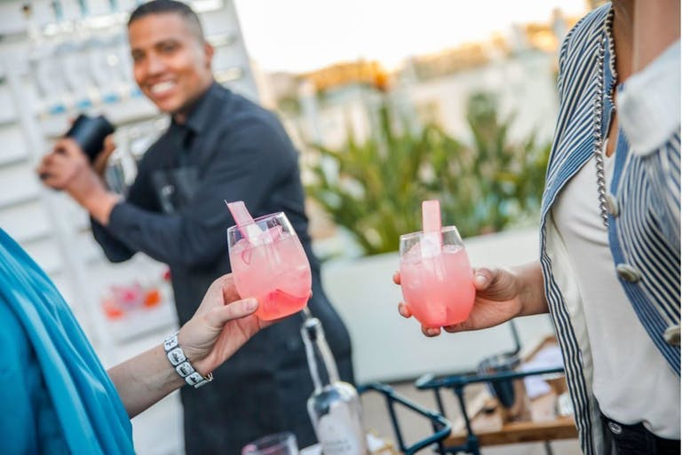 Pink Summer Pool Party Cocktails With Rhubarb Garnish | PartySlate