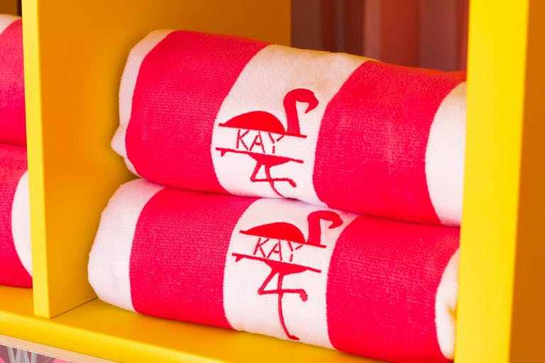 Pink and White Flamingo Towel Party Swag in Yellow Shelving | PartySlate