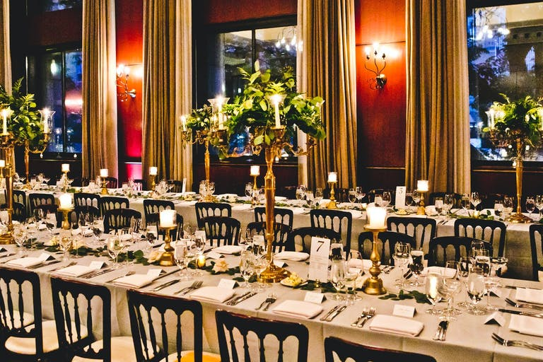 Wedding at The Newberry Library With Gold Candelabra Centerpieces Wrapped in Greenery   PartySlate