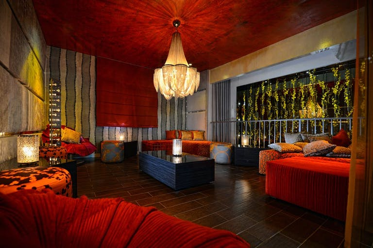 Barton G. Private Rooms Miami. Red With Textured Red Ceilings and Furniture | PartySlate
