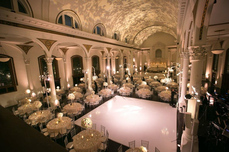 Wedding at Vibiana in Los Angeles With Dappled Tree Leaf Projections on Ceiling and Pearly White Dance Floor | PartySlate