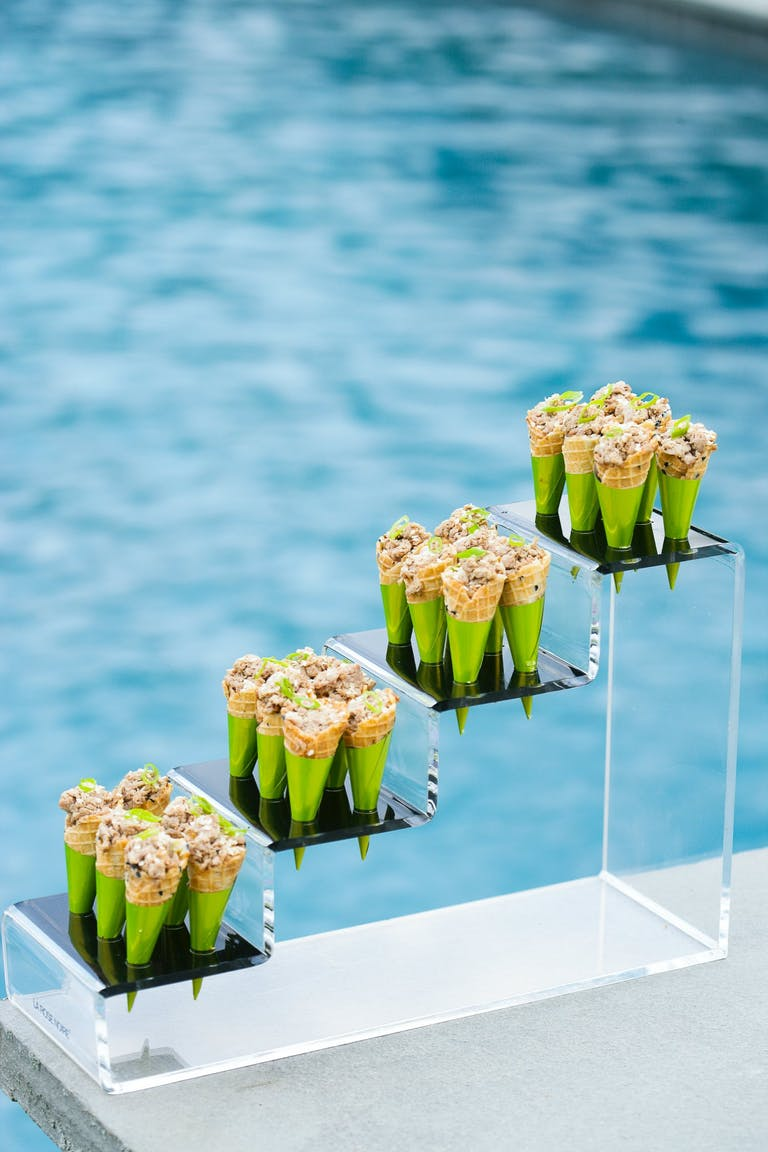 Savory Ice Cream Cones On Lucite Shelving Against Swimming Pool Backdrop | PartySlate