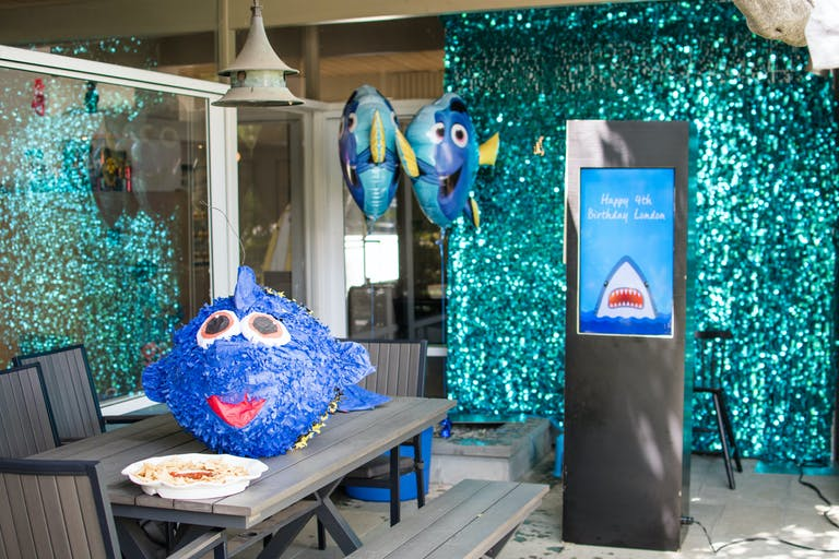 Shark Attack Themed Kids 4th Birthday Party with Shark Photo Booth Props and Blue Streamers | PartySlate