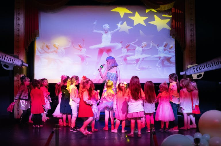 Taylor Swift Themed Kids Birthday Party in Dallas, Texas with Taylor Swift Look-Alike Performer Stage and Projector Screen | PartySlate