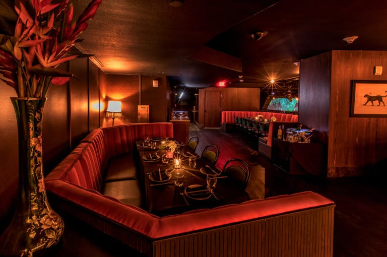 Dining Room at El Tucán With Red Booth and Moody Lighting in Miami, Brickell Neighborhood | PartySlate