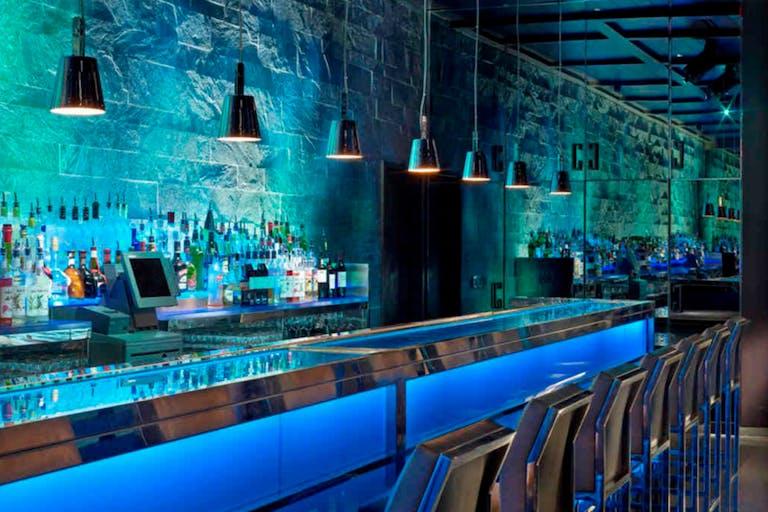Miami Beach Hakkasan Bar With Blue and Green Uplighting | PartySlate