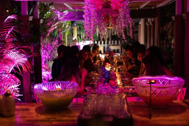Private Party With Pink Uplighting in Garden at 27 Restaurant & Bar in Miami Beach, FL | PartySlate