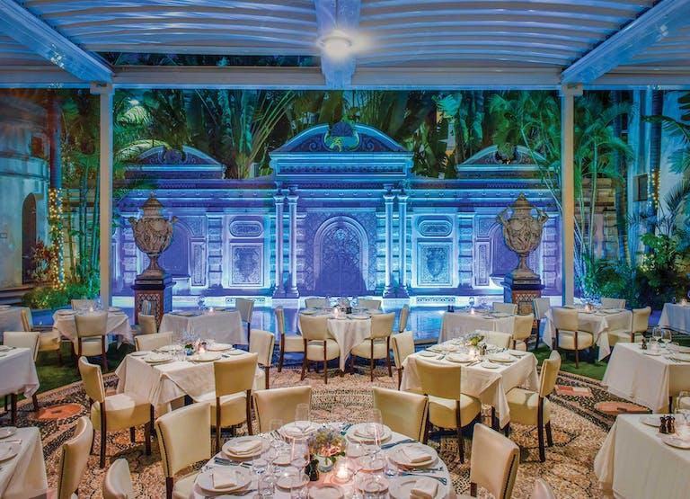 Gianni's Restaurant Villa With Blue Uplighting | PartySlate