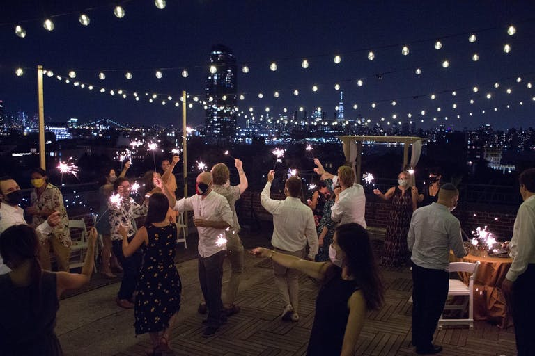 Rooftop Micro Wedding Dance Party With Fairy Lights at Night   PartySlate