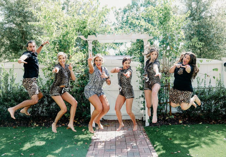 Two Brides and Friends Jump For Joy in Cat-Print PJs   PartySlate