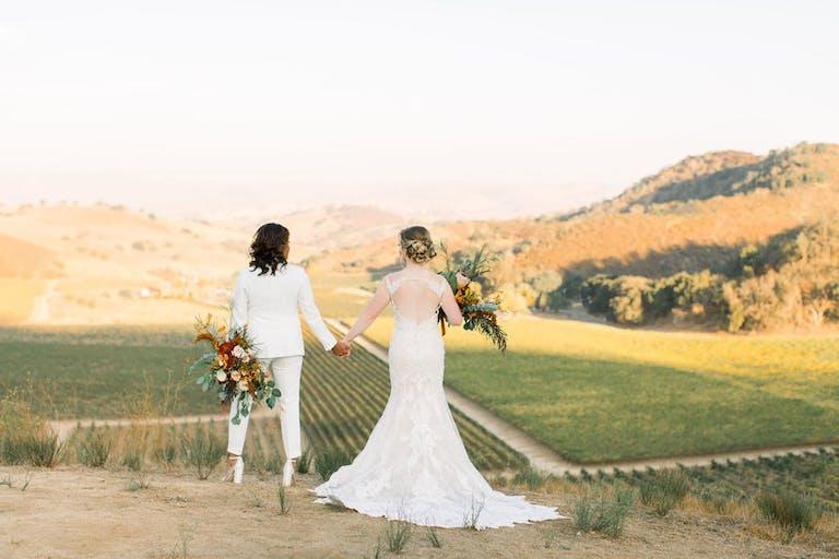 Couple Walk Through Eden Rift Vineyards   PartySlate