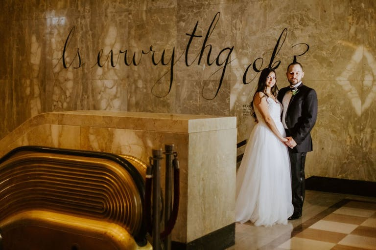 Bride and Groom Pose in Lobby of The Historic Alfred I. Dupont Building   PartySlate