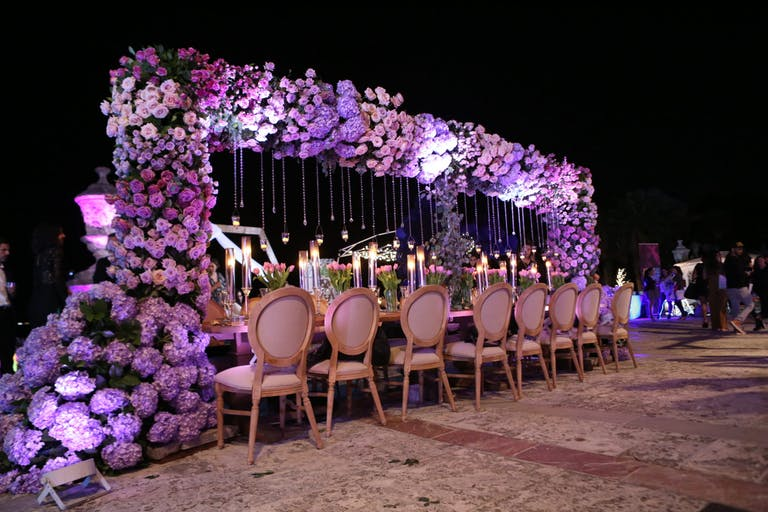Vizcaya Miami Wedding Reception With King's Table and Elevated Purple Hydrangea Centerpiece Cascading Off One Side of Table | PartySlate