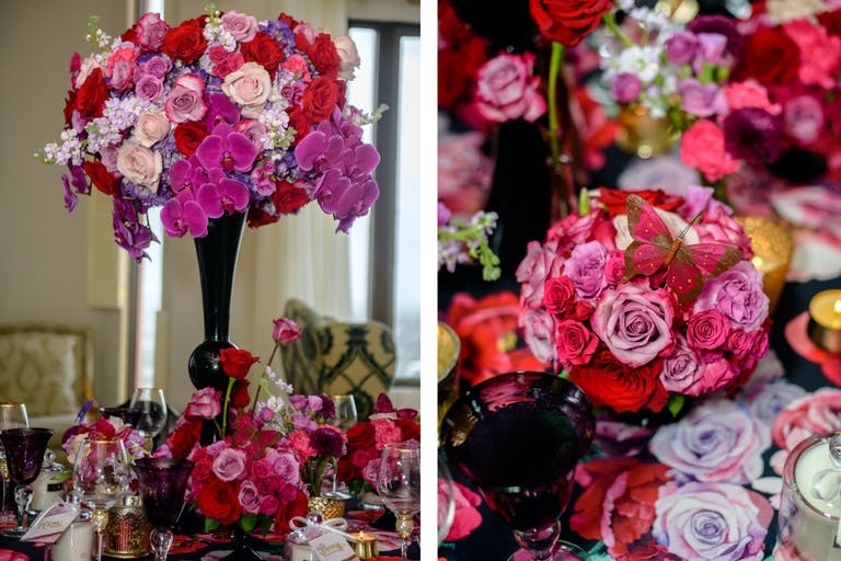 Red, Pink, and Purple Floral Centerpieces With Black Vase and Butterfly Details | PartySlate