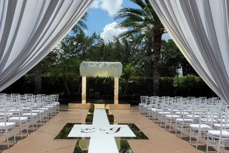 Modern Outdoor Wedding Ceremony With Gold Mirrored Arch and Wedding Aisle | PartySlate