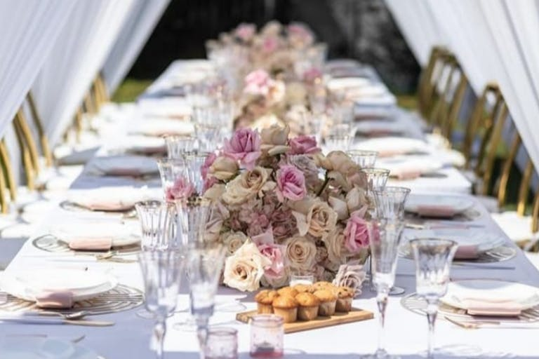 Wedding Tablescape With White Linen and Pink Florals | PartySlate