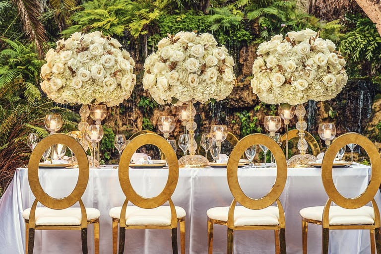 Wedding Tablescape With Gold Seating and Elevated White Floral Centerpieces | PartySlate