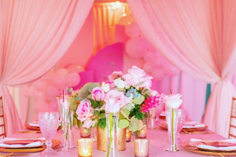 Pink Wedding With Pink Drapery and Centerpieces | PartySlate