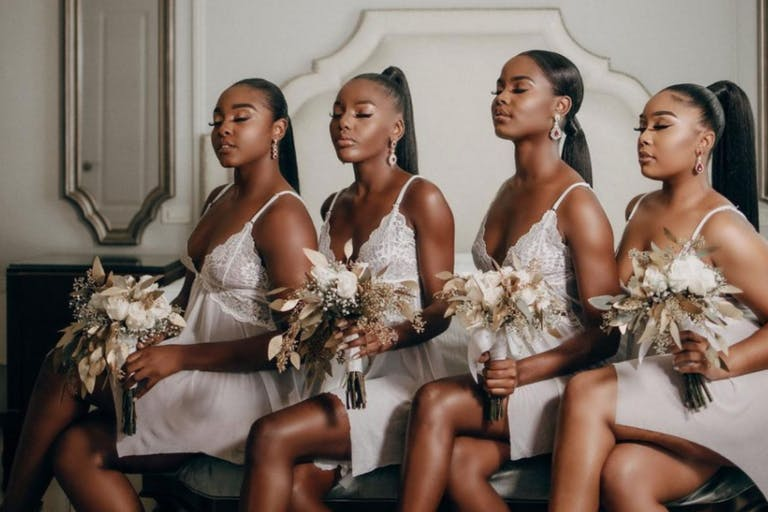 Four Bridesmaids Pose With Hair and Makeup Done | PartySlate