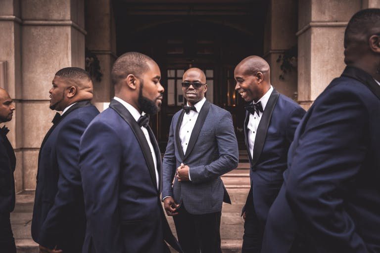 Grooms Men in Blue Suits and Black Sunglasses | PartySlate