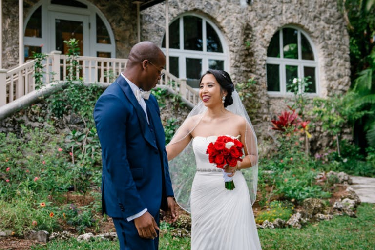 Bride and Groom's First Look at Coconut Grove Events' Lush Garden | PartySlate
