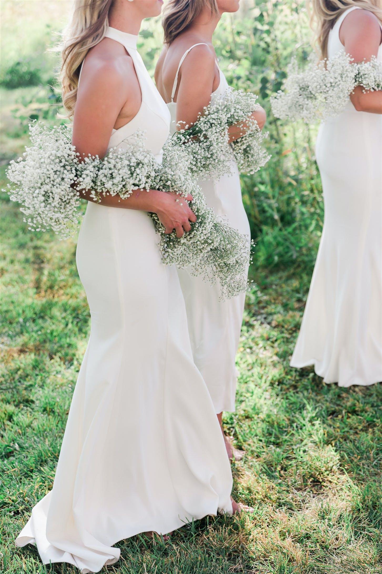 Bridesmaids in White Dresses Wear Baby's Breath Boas   PartySlate