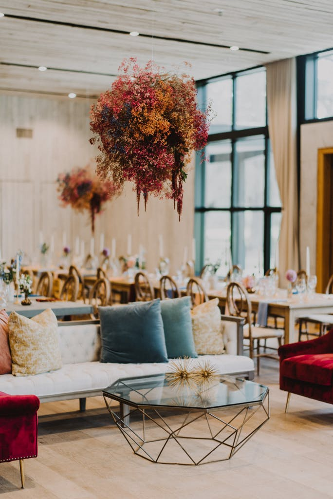 Eclectic and Colorful Wedding Reception Area With Colorful Baby's Breath Ceiling Installation   PartySlate