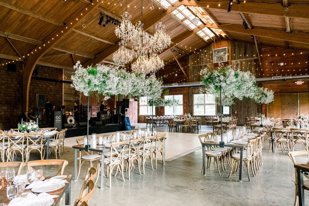 Rustic Barn Wedding Reception With Elevated Baby's Breath and Greenery Wedding Centerpieces   PartySlate
