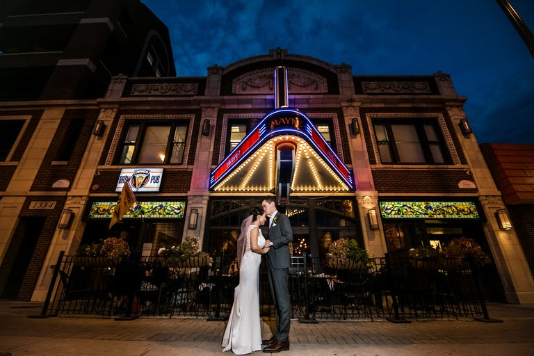 Couple Embrace for Wedding Photo Op Outside of Mayne Stage in Chicago, IL   PartySlate