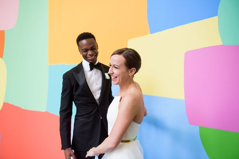 Bride and Groom Pose in Front of Colorful Abstract Painting for Wedding at Museum of Contemporary Art Chicago   PartySlate