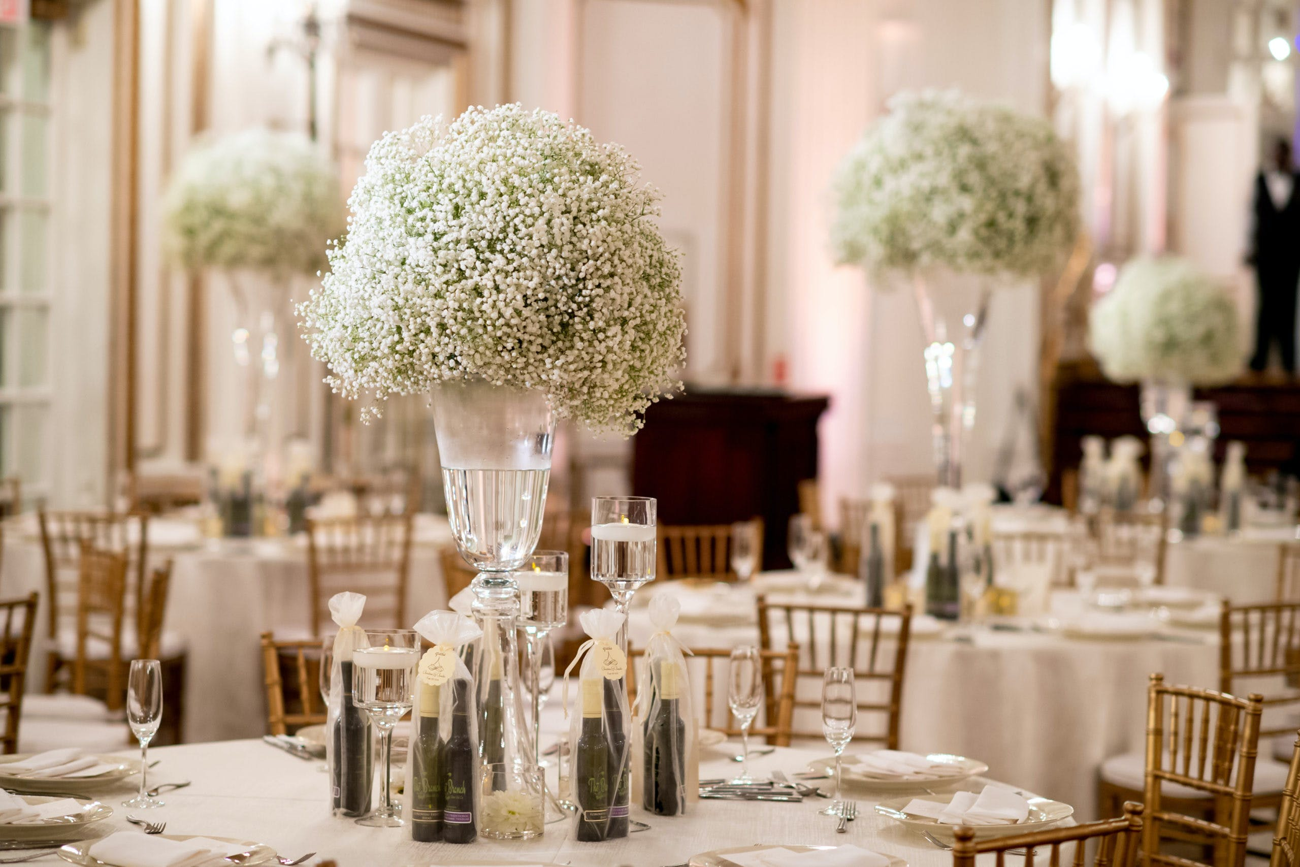 Bouquets of Baby's Breath Wedding Centerpieces At Varying Heights   PartySlate