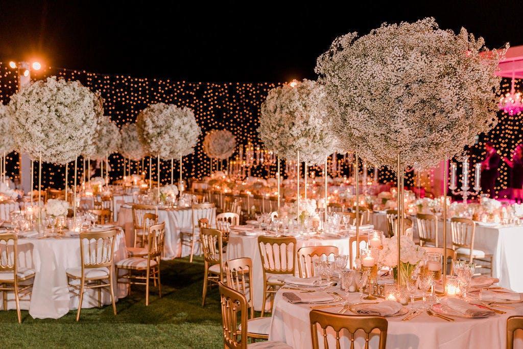 Elegant Night Wedding Reception With Lavish Cloud-Like Baby's Breath Centerpieces   PartySlate