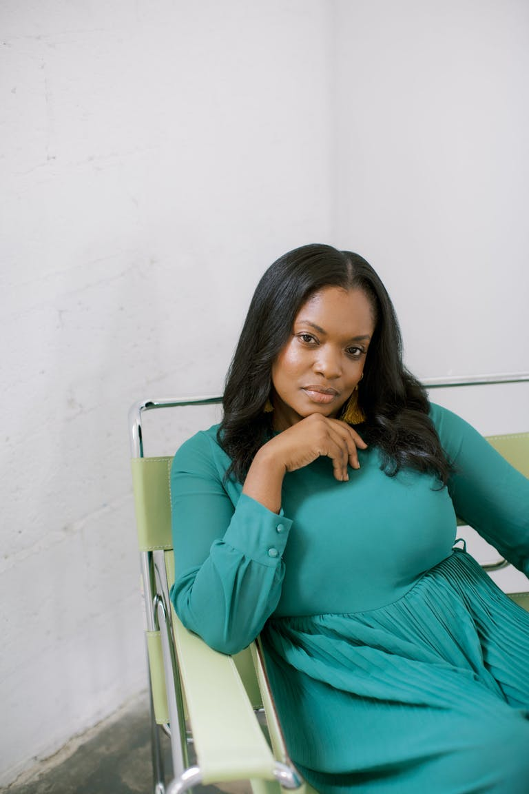 Natalie Thames of Déjà vu Sweets Wears a Green Dress | PartySlate