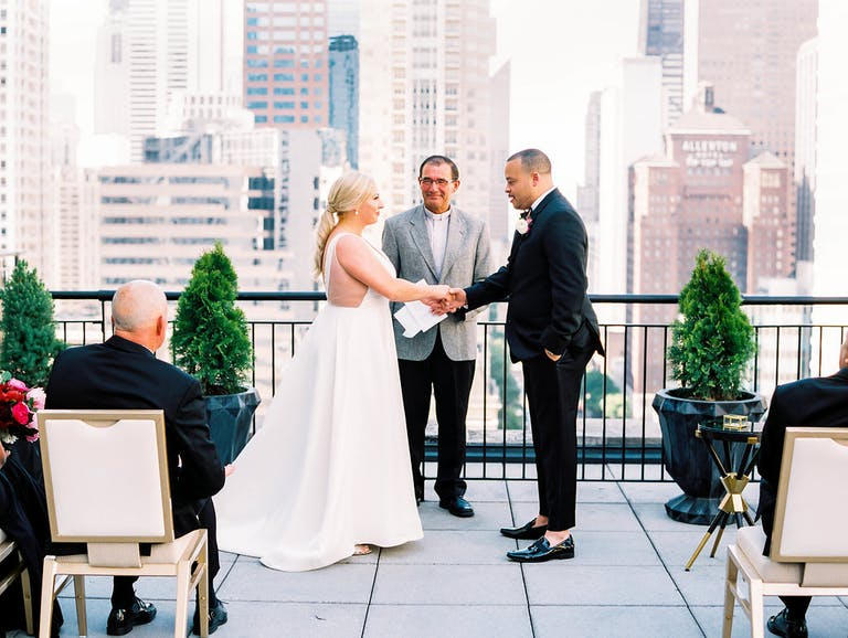 Bride and Groom Exchange Vows at Intimate Rooftop Wedding Ceremony at The Gwen, a Luxury Collection Hotel, Chicago