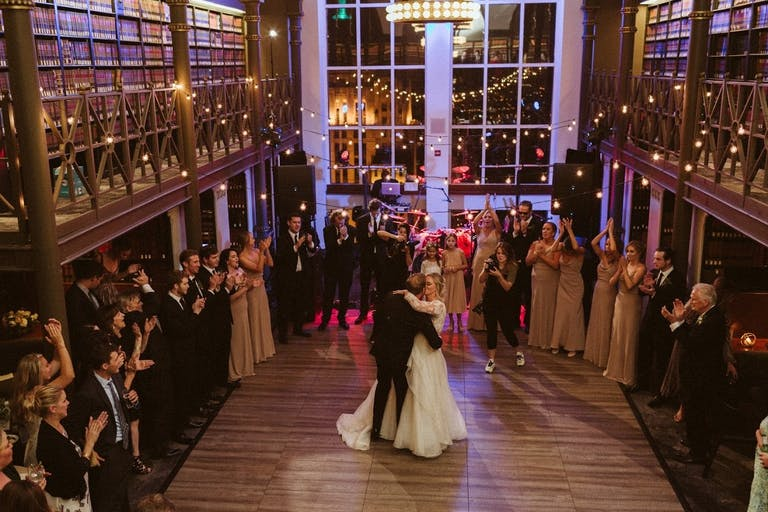 Bride and Groom Dance at The Library at 190 South LaSalle, Surrounded by Books   PartySlate