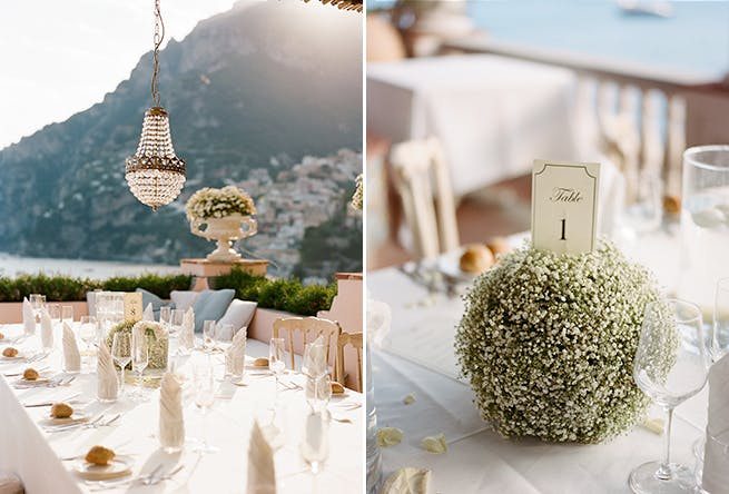 Outdoor Wedding Reception in Positano With Tables Numbers Resting on Orbs of Baby's Breath   PartySlate