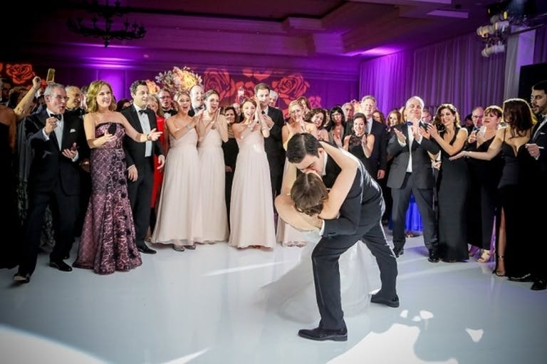 Bride and Groom Kiss on White Polished Dance Floor at The Ritz-Carlton, South Beach | PartySlate