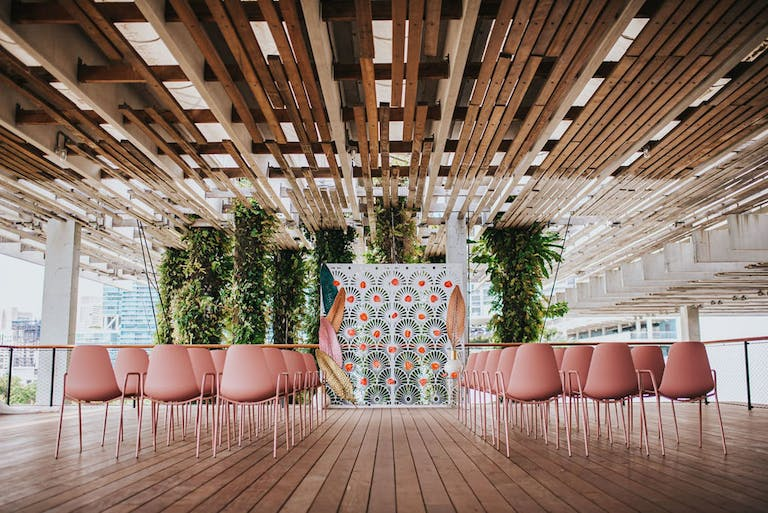 Contemporary Ceremony at Pérez Art Museum With Pink Seating and Eclectic Backdrop | PartySlate