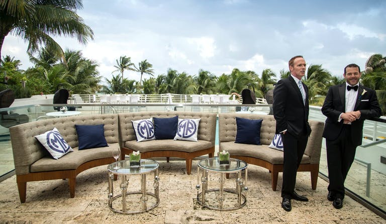 Grooms Pose at Lounge Area at Royal Palm South Beach With Ocean Views | PartySlate