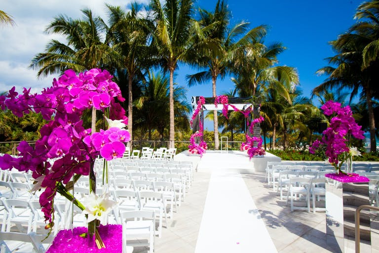 Modern Wedding Ceremony With Hot Pink Orchids at The St. Regis Bal Harbour Resort, Bal Harbour | PartySlate