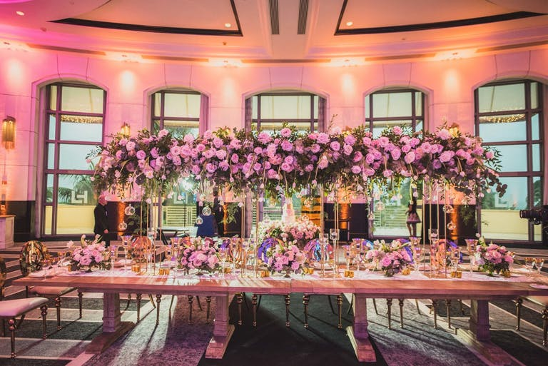 Pink Floral Wedding Reception at Loews Miami Beach Hotel | PartySlate