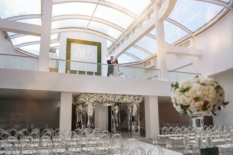 Bride and Groom Pose at 1 Hotel South Beach, One of the Top Miami Beach Hotels for Weddings | PartySlate