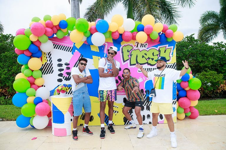 Friends Pose in Front of Fresh Prince of Bel-Air Balloon Backdrop for Birthday Party | PartySlate