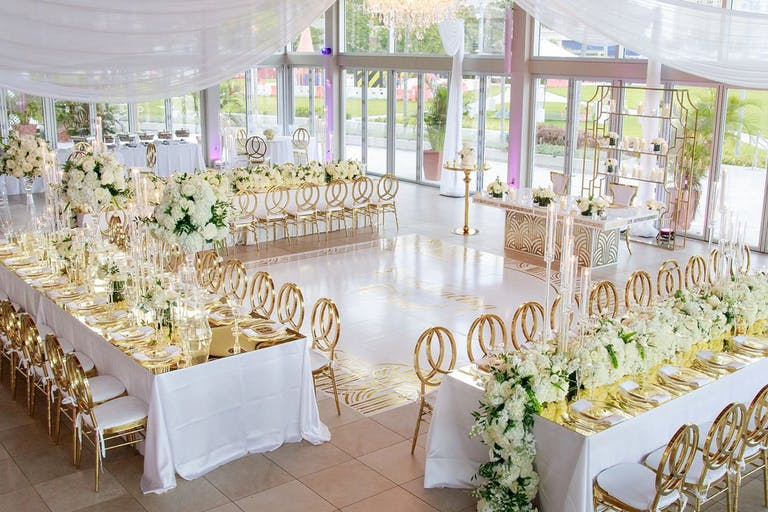 Bright and Airy Wedding With Gold Seating and Floor-to-Ceiling Windows | PartySlate