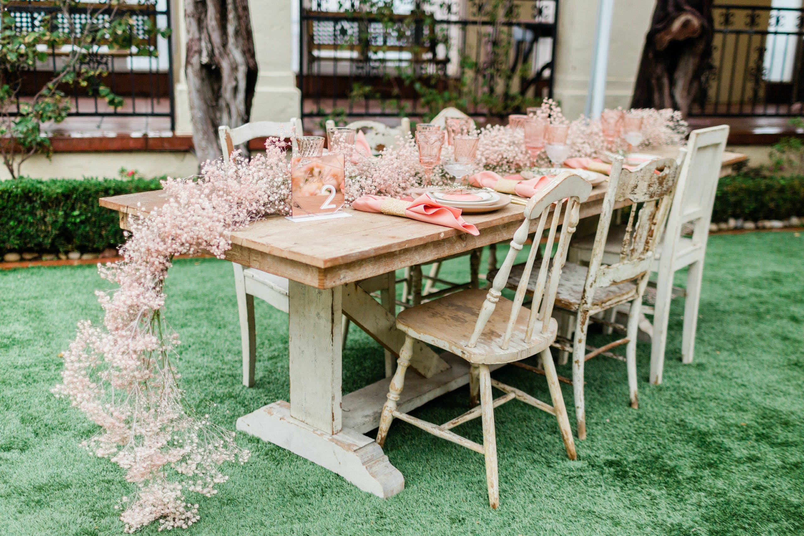 Rustic Wedding Tablescape With Pink Baby's Breath Centerpiece Cascading Off Table   PartySlate