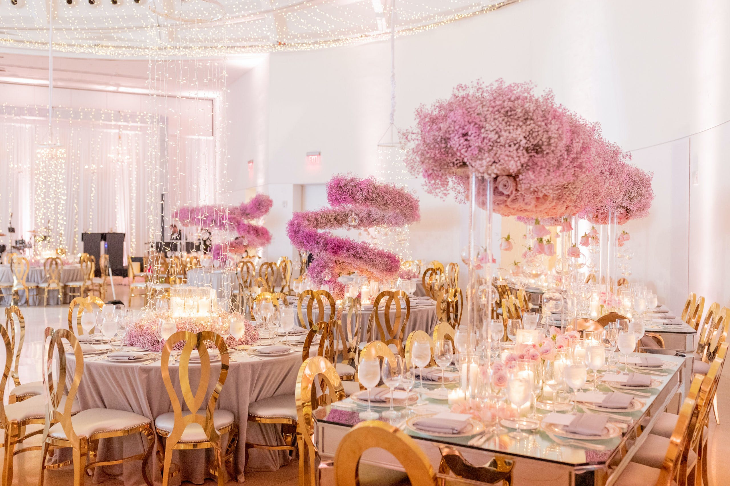 Modern Wedding Reception with Gold Tablescapes and Pink Corkscrew Baby's Breath Centerpieces   PartySlate
